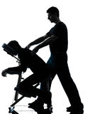 Back massage therapy with chair silhouette Stock Images
