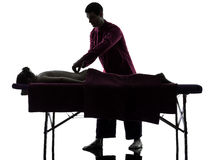 Back massage therapy silhouette Stock Photo