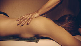 Back Massage. Young Woman Receiving Back Massage At Spa royalty free stock photography