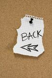 Back message on pinboard. Word BACK written on ripped paper on pinboard Royalty Free Stock Photo