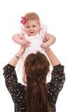 Back of mom raise her baby girl Stock Image