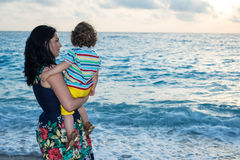 Back of mom and son looking at sea Royalty Free Stock Image