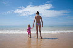 Back mother and baby at ocean Royalty Free Stock Photography