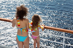 Back of mother and daughter dressed in swimsuits Stock Photography