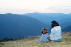 Back of mother and son in the mountains royalty free stock images