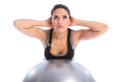 Back muscle exercise by woman on fitness ball Royalty Free Stock Photography