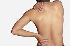 Back muscle pain and shoulder with health problems. Of Office Syndrome in Working computer stock photos