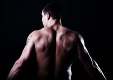 Back of muscular guy Royalty Free Stock Photos