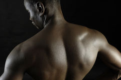 Back of a naked African boy Stock Photography
