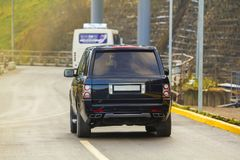 Back of new black SUV car parking on the asphalt road Stock Photography