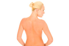 Back of a nude woman. In the white background stock photos