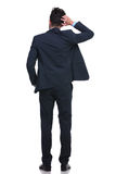 Back Of A Young Business Man Scratching His Head Royalty Free Stock Photos