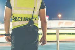 Free Back Of Security Standing In The Soccer Stadium. Stock Photo - 119798650