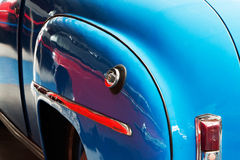 The back of old blue car close up Stock Photography
