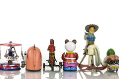Back of Old Tin Toys. Back view of a group of old tin wind up toys Stock Photo