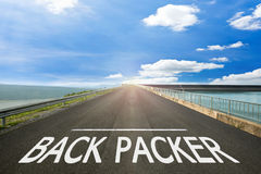 BACK PACKER - Road surface of begin to the trip. Royalty Free Stock Photo