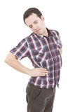 Back pain. A young man with a pain in his back Royalty Free Stock Images