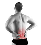 Back pain. Young man with back pain in the red zone royalty free stock photo