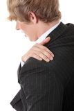 Back pain. Man with shoulder pain isolated Stock Photography