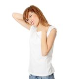 Back pain. Teen student woman with back pain, isolated royalty free stock images
