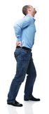 Back pain. Young man with pain in his back isolated on white Royalty Free Stock Photos