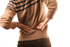 Back pain. Attractive young woman with back pain Royalty Free Stock Photo