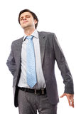 Back pain. Young businessman with strong back pain, isolated on white background Stock Image