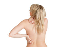 Back pain. Young blond woman has back pain royalty free stock photography