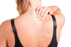 Back Pain. Young woman with pain in the back of her neck Stock Photography