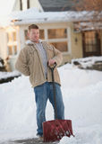 Back pain. Man with back pain from shoveling snow Stock Images