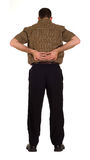 Back Pain. Full body view of a man suddering from back pain, isolated against a white background royalty free stock photo