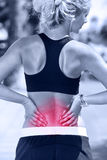 Back pain - Athletic running woman with injury royalty free stock photos