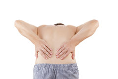 Back Pain. Caucasian man touching lower back with both hands on white background stock images