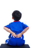 Back pain. Child rubbing the muscles of his lower back Stock Photography
