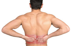 Back pain. Closeup of young shirtless man with back pain over white background Royalty Free Stock Image