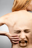 Back pain concept. Waist spine in agony Royalty Free Stock Images