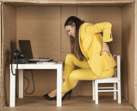 Back pain, cramped office and lack of space.  royalty free stock image
