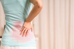 Back pain at home. women suffer from backache. healthcare and medical concept Royalty Free Stock Image
