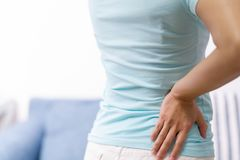 Back pain at home. women suffer from backache. healthcare and medical concept Stock Photography