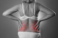 Back pain, kidney inflammation, ache in woman`s body Royalty Free Stock Images