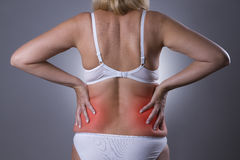Back pain, kidney inflammation, ache in woman`s body stock photos