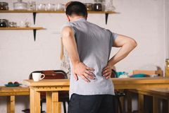 Back pain, kidney inflammation, man suffering from backache. At home royalty free stock images
