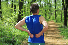 Back pain. Man Runner lower back pain injury Stock Photo