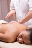 Back pain and massage Stock Image