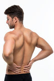 Back pain. Muscular man with back pain Stock Photos