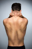 Back pain. Muscular man with back pain Stock Images