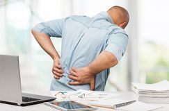 Back pain in office. Back pain office low massage ache royalty free stock images