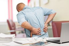Back pain in office. Back pain office low massage ache Stock Images