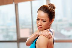 Back pain. Sportswoman having pain in her back Stock Photography