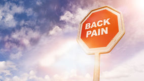 Back Pain, text on red traffic sign Stock Images